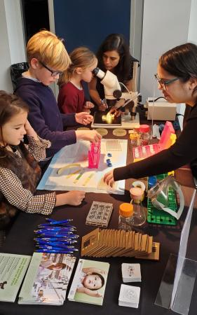 children engage in science activities at an information booth